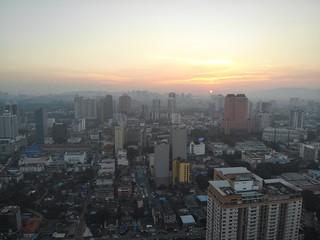 Fotobehang Bangkok HIGH ANGLE VIEW OF BUILDINGS AGAINST SKY DURING SUNSET