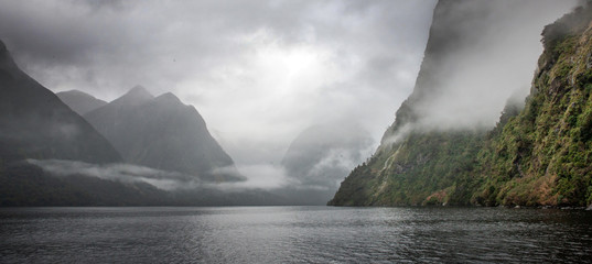 Clouds and fog at Doubtfull Sound. Fjordland New Zealand. South Island.