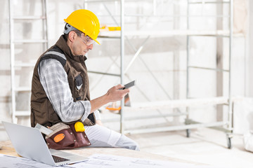Builder or contractor using a mobile phone on site
