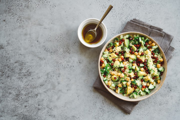 Quinoa salad with chickpeas, cucumber, avocado, parsley and pomegranate seeds