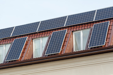 Solar panels for green energy on the tiled roof of house, Photovoltaic module and regenerative energy system.