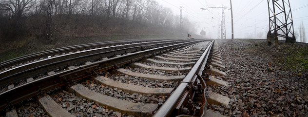 Railroad Tracks In Foggy Weather