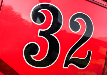 Wall Mural - number 32 on the door panel of a race car