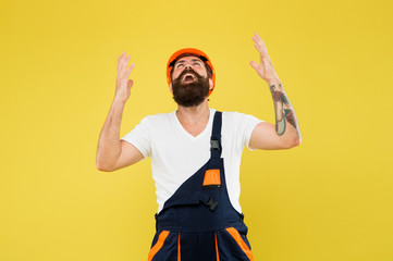Finally. Engineered environment trend. Builder hard hat. Improvement and renovation. Brutal man builder. Bearded guy worker on yellow background. Engineer builder uniform. Home decor. Feel relief