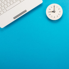 Clock and keyboard on blue background