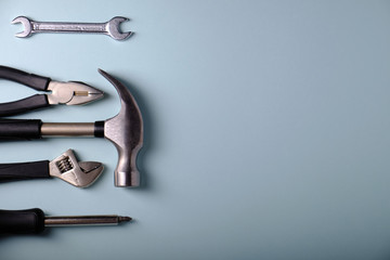 Tools on a gray background, hammer, place for an inscription