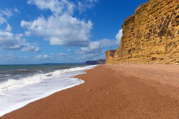 Wall Mural - Jurassic coast Dorset UK at Freshwater beach with sandstone cliffs on walk towards West Bay