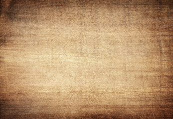 Brown scratched wooden cutting board. Wood texture Wall mural