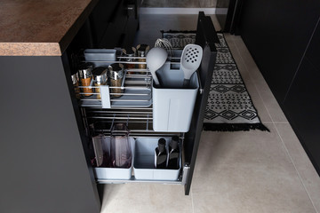 Kitchen storage solution. Pull out kitchen accessory for spice, bottles, kitchen spoons and even cutting boards.