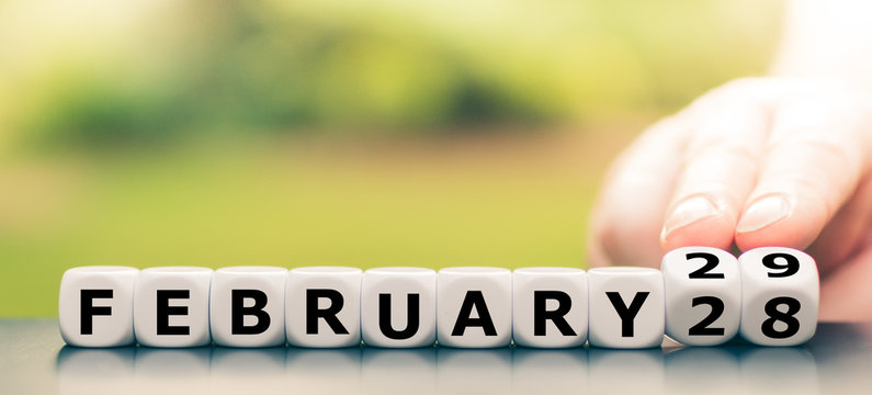 "Hand turns dice and changes the date from ""February 28"" to ""February 29""."