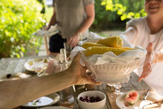 millennial friends eating brunch outdoors during summer