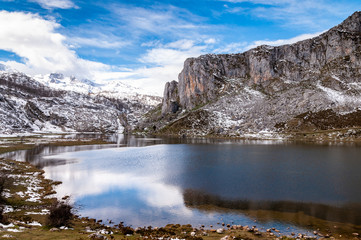 Reflections of snowy mountains over Covadonga Lakes