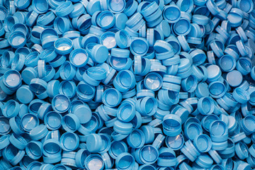 Plastic bottle caps background. Recycling collection and production processing plastic bottle caps