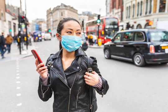 Chinese woman in London wearing face mask to protect from smog and virus
