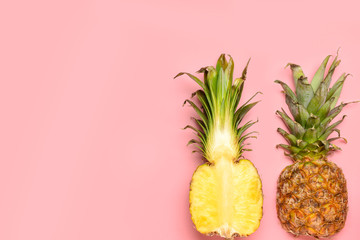 Fresh ripe pineapples on color background