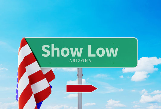 Show Low – Arizona. Road or Town Sign. Flag of the united states. Blue Sky. Red arrow shows the direction in the city. 3d rendering