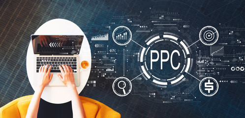 Wall Mural - PPC - Pay per click concept with person using a laptop on a white table