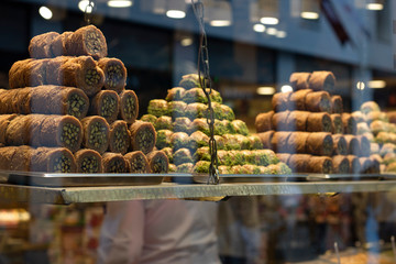 Traditional fresh baklava with pistachio nuts, pyramid shop display.