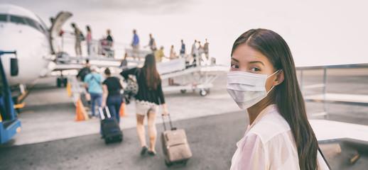 Airport Asian woman tourist boarding plane taking a flight in China wearing face mask. Coronavirus...