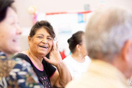 Smiling Hispanic Woman in a Senior Activity Center