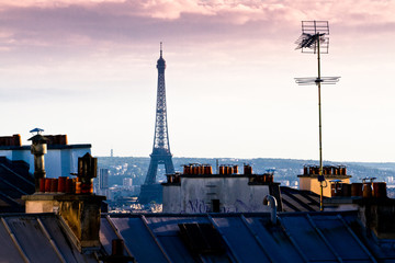 Fototapeta Eiffel Tower Amidst Buildings In City Against Cloudy Sky