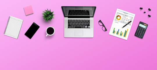 Top view office desk and supplies, with copy space. Creative flat lay photo of workspace desk/Panoramic banner isolated on pink background