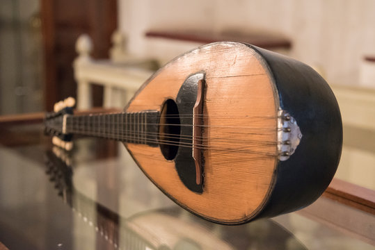 Close-Up Of Mandolin On Table