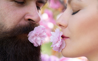 Valentines Day. Young lovers couple. Romantic and love. Sensual touch. Kissing couple in spring nature close-up portrait.