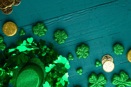 Traditional Irish holiday St. Patrick's Day, March 17th celebration, with accessories for teething on a green wooden background.