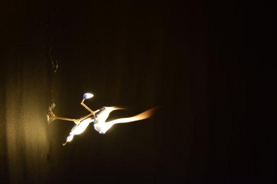 Burning Matchstick In Darkroom
