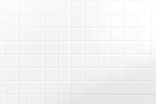 White tiles wall texture for the decoration of the cafe.