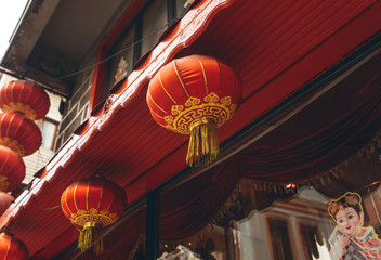 Traditional asian or oriental red lanterns on a building.