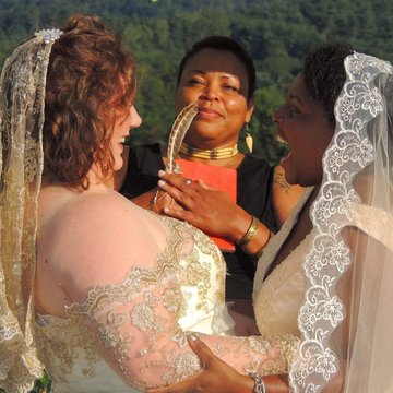 Marriage Officiant Looking At Cheerful Lesbian Couple Getting Married