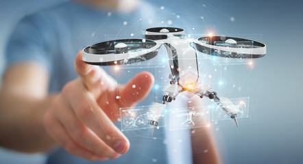 Businessman holding and touching modern drone in his hands 3D rendering