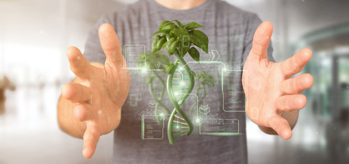 Businessman holding a DNA growing as a plant - 3d rendering