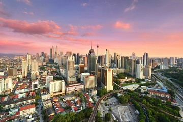 Wall Murals Aerial View Of Buildings In City Against Sky During Sunset