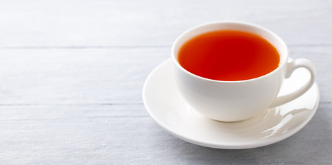 Cup of tea on a grey wooden background. Copy space. Close up.