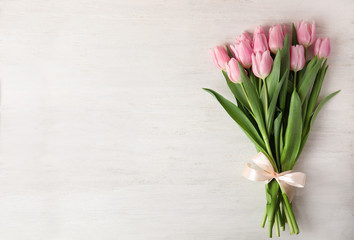 Fototapeta Beautiful pink spring tulips on white wooden background, top view. Space for text obraz