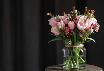 Keuken foto achterwand Tulp Beautiful bouquet with spring pink tulips on wooden table. Space for text