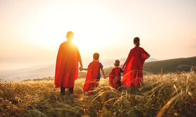 concept of super family, family of superheroes at sunset