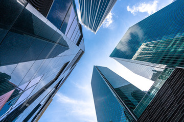 Wall Mural - modern office building with blue sky and clouds