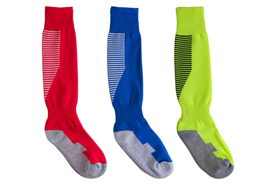 three pairs of colored football leggings horizontally located on a white background, high socks for sports