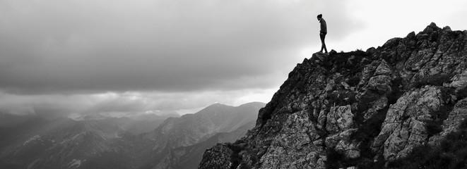 Printed kitchen splashbacks Eastern Europe Man Walking On Mountain Against Sky