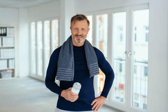 Smiling friendly athletic middle-aged man