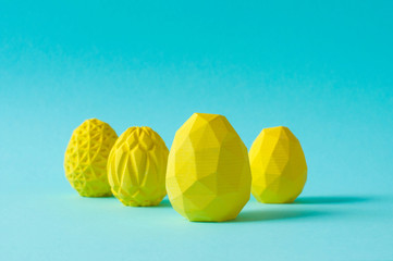 Yellow geometric Easter eggs on blue background