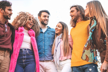 Happy diverse friends standing, embracing, joyful multiracial students or colleagues group in good friendly relations having fun, young people enjoying meeting, hanging together outdoors Fotomurales