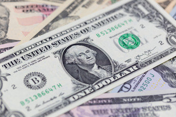 Business background, one dollar bill on american banknotes close up in studio macro photo