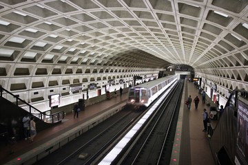 WASHINGTON, USA - JUNE 12, 2013: People wait for subway train in Washington. With 212 million annual rides in 2012 Washington Metro is the 3rd busiest rapid transit system in the USA.