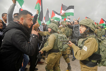A Palestinian demonstrator argues with Israeli forces during a protest against the U.S. president Donald TrumpÕs Middle East peace plan, in Jordan Valley in the Israeli-occupied West Bank