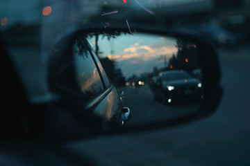Fotomurales - vehicle car travel road trips at town with twilight sky view on sideview of mirror